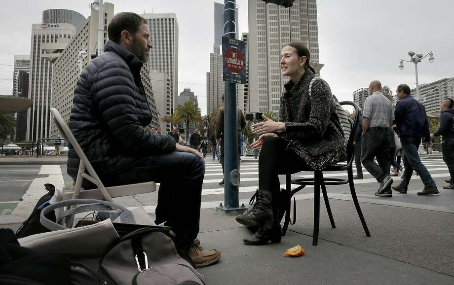 Rachel Pickel, (right) talks to listener Shanon Sitkin during ÒSidewalk Talk,Ó a one-day event designed to promote listening and destigmatize therapy, in front of the Ferry Building along the Embarcadero as seen in San Francisco, Calif., as seen on Thurs. May 7, 2015. Photo: Michael Macor, The Chronicle