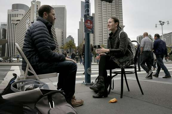 Rachel Pickel, (right) talks to listener Shanon Sitkin during ÒSidewalk Talk,Ó a one-day event designed to promote listening and destigmatize therapy, in front of the Ferry Building along the Embarcadero as seen in San Francisco, Calif., as seen on Thurs. May 7, 2015.