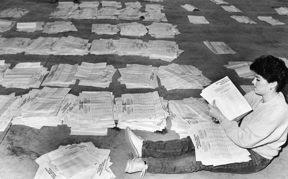 Volunteer Kim Gilmore sorts individual precinct chairman ballots for counting, 1988.