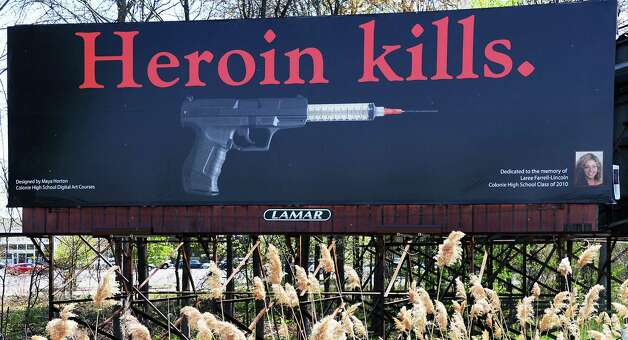 Colonie Central High School's annual billboard project, this year  in memory of Colonie graduate lost to heroin use, Laree Farrell-Lincoln Thursday May 7, 2015 on NY State route 155 near the intersection of 155 and Central Ave. in Colonie, NY.  (John Carl D'Annibale / Times Union) Photo: John Carl D'Annibale / 00031757A