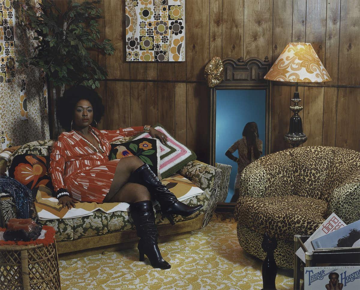 """Sista Sista Lady Blue"" (2007), a chromogenic 1970s-style print by feminist artist Mickalene Thomas."