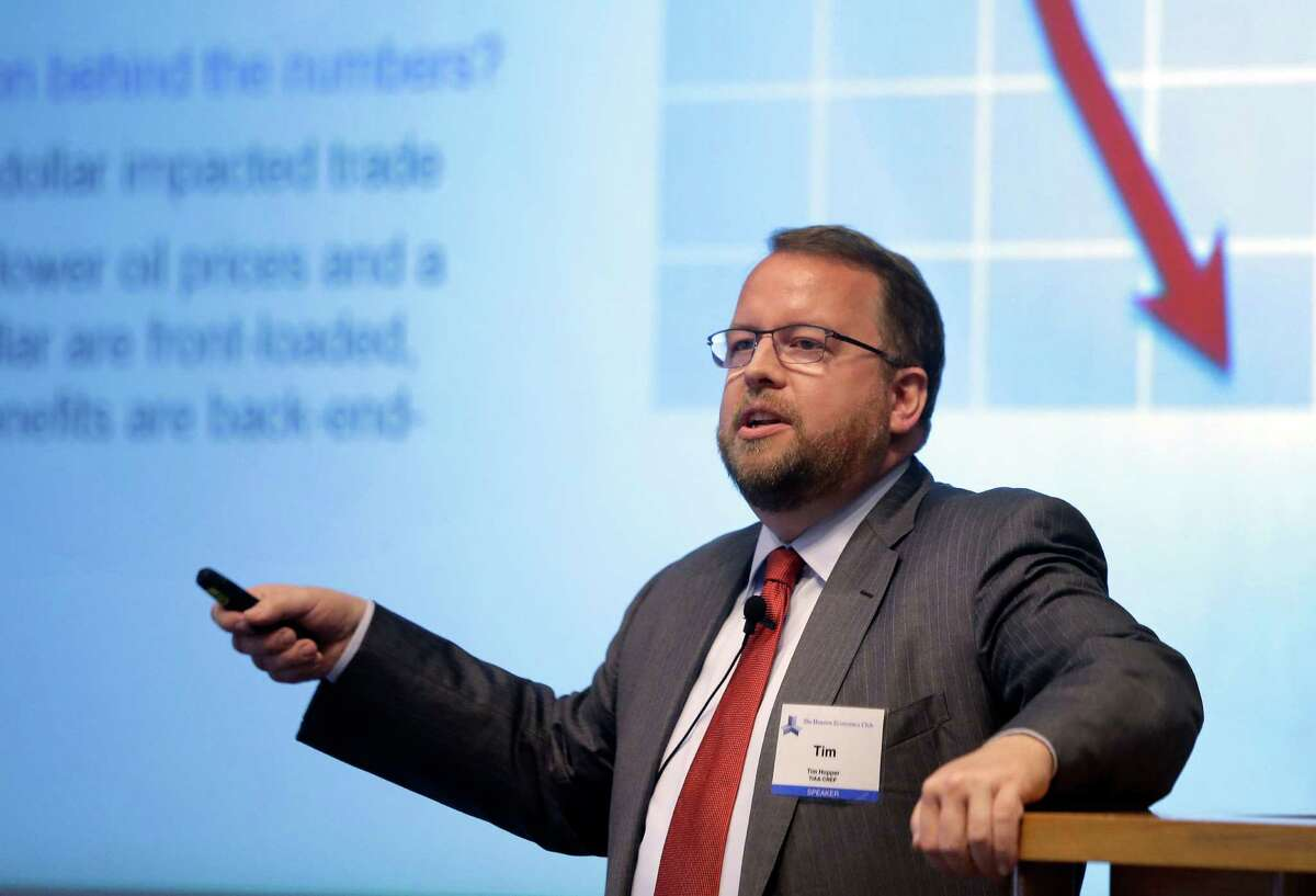 """Tim Hopper, managing director and chief economist for TIAA-CREF, speaks to The Houston Economics Club at the Federal Reserve Bank, 1801 Allen Parkway, during a presentation titled """"Triple Crown or Triple Threat? Oil, Trade and the US Economy's Current Influence on Houston"""", Wednesday, May 6, 2015, in Houston. ( Melissa Phillip / Houston Chronicle )"""