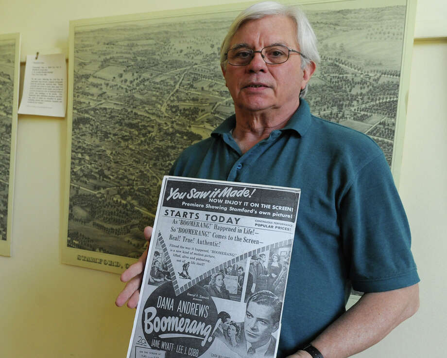 """Historian Dan Burke holds an old advertisement for the classic 1947 film """"Boomerang!' which was filmed in Stamford, at the Stamford Historical Society in Stamford, Conn. Thursday, May 7, 2015. Photo: Tyler Sizemore / Greenwich Time"""