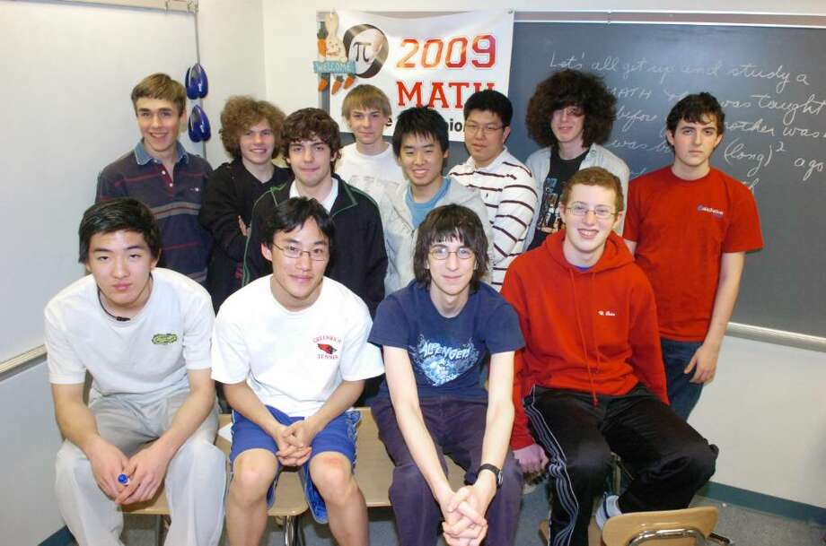 After winning a regional contest, the Greenwich High School math team is headed to the championship round of a state-wide math competition that it won last school year. The team breaks from studying at GHS Tuesday afternoon, March 9, 2010. Front row from left, Ryota Ishizuka, team captain Jae Lee, Greg Edelston and Warren Bein. Back row from left, Connor Harris, Daniel Keller, Joe DiMatteo, Christian Geske, Yuhei Urakami, Daniel (Hyunwoong) Chang, Henry Armero and Paul Angland. Photo: Keelin Daly / Greenwich Time