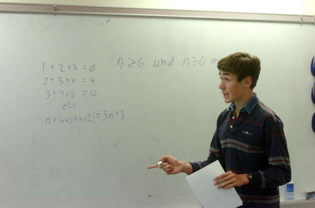 The Greenwich Math Team's Connor Harris works out a problem as the team studies at GHS Tuesday afternoon, March 9, 2010. After winning a regional contest, the math team is headed to the championship round of a state-wide math competition that it won last school year. Photo: Keelin Daly / Greenwich Time