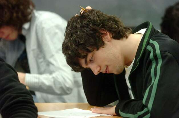 The Greenwich Math Team's Joe DiMatteo solves a math problem as the team studies at GHS Tuesday afternoon, March 9, 2010. After winning a regional contest, the math team is headed to the championship round of a state-wide math competition that it won last school year. Photo: Keelin Daly / Greenwich Time