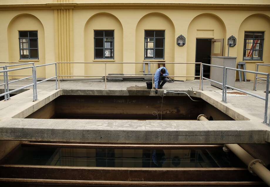 Lyle Hernandez replaces conductivity probes in a filtration tank at Orinda Water Treatment Plant in Orinda, Calif., on Thursday, May 7, 2015. Photo: Scott Strazzante, The Chronicle