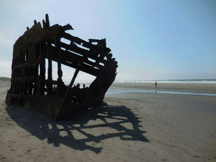 The skeleton of the Peter Iredale, shipwrecked in 1906, is a highlight of a visit to the beach at Oregon's Fort Stevens State Park. Photo: Rob Owen /McClatchy-Tribune News Service / Pittsburgh Post-Gazette