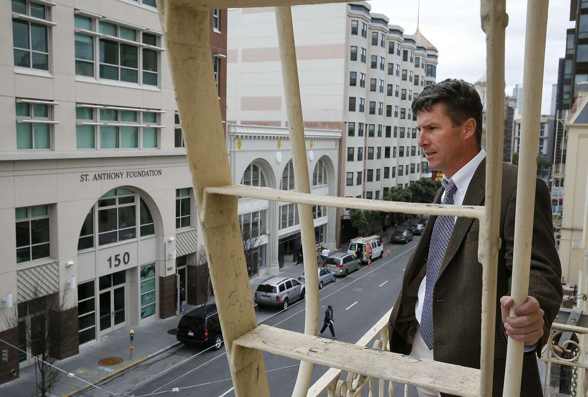 Mike Anderer, Vice President of Mission Advancement at De Marillac Academy poses for a portrait as he overlooks the corner of Golden Gate and Leavenworth from his school's fire escape May 7, 2015 across the street from the building 826 Valencia has signed a lease to take over in the Tenderloin in San Francisco, Calif. Among many other neighborhood duties, Anderer also facilitates the Golden Gate block safety group.