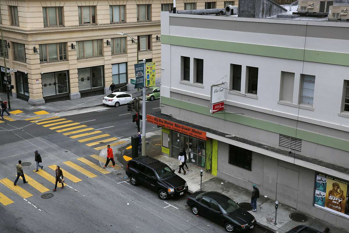 Pedestrians walk near the corner of Golden Gate and Leavenworth May 7, 2015 outside of the building 826 Valencia has signed a lease to take over in the Tenderloin in San Francisco, Calif.