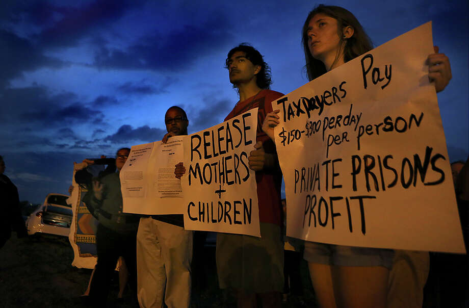 A vigil is held in March at a Karnes County detention center. The federal government says such centers in South Texas are now used for short-term processing of immigrant families. Photo: Bob Owen /San Antonio Express-News / ©2015 San Antonio Express-News