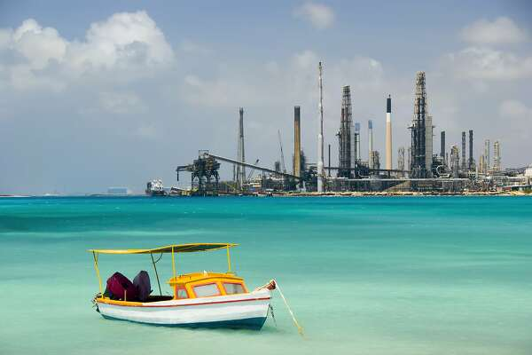 Valero Energy Corp.'s refinery in Aruba sits along the island's breath-taking beaches. The oil company has shuttered the refinery damaging the country's economy.