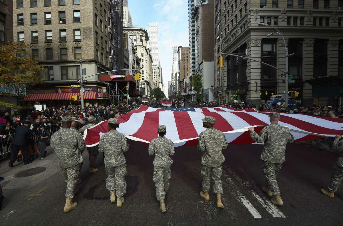 Texans honor the military service of men and women from all states. But in passing the Hazlewood Act, the Legislature did not intend that a veteran born in say, Georgia, who enlisted there could move to Texas and attend a state university for free. (AFP/Getty Images)