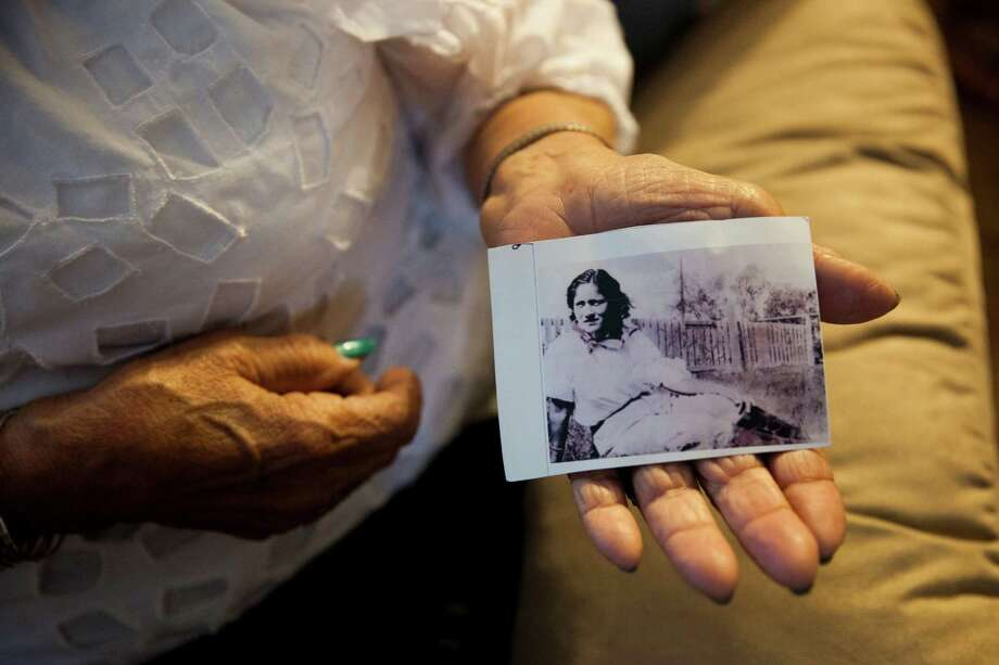 "Golden age ranchera singer Rita Vidaurri, 90, holds a photograph of her mother in her home Monday May 4, 2015. Vidaurri's mother died when Rita was 13 years old, ""My mother was an angel."" Photo: / / Julysa Sosa For the San Antonio Express-News"