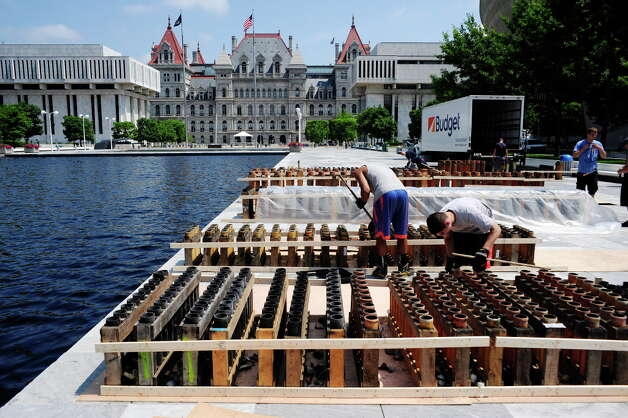 Workers with Alonzo Fireworks set up the tubes that will hold the fireworks on Thursday, July 3, 2014, at the Empire State Plaza in Albany, N.Y.  The workers were getting the tubes ready for the fireworks show that will be part of Friday's Independence Day celebration at the Plaza.  (Paul Buckowski / Times Union) Photo: Paul Buckowski / 00027615A