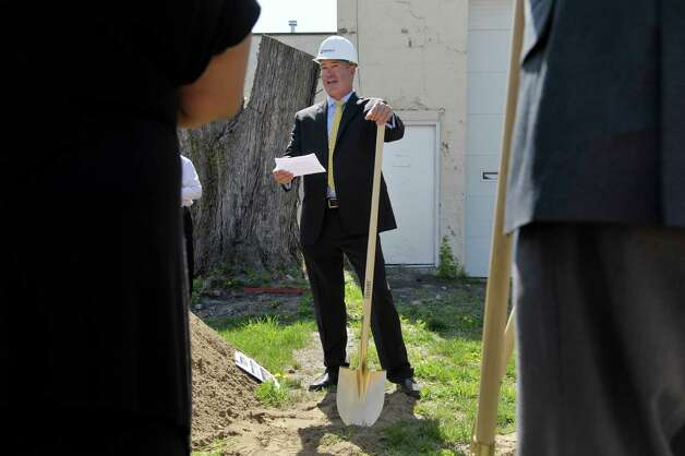 Ken Brownell, managing director of Vanguard-Fine Commercial Real Estate, addresses those gathered at a groundbreaking for a Family Dollar store in Albany's South End on Thursday, May 7, 2015, in Albany, N.Y.  The 8,320 square-foot store will be open in the fall before the holidays and will employ between 10 and 12 people.  The store will being interviewing candidates for jobs about three weeks before the store opens and will advertise when the interviews begin.  The current building on the site will be knocked down and the ground will be raised to street level before a new building is constructed.  Vanguard-Fine Commercial Real Estate is the developer on the project.  Family Dollar has 8,000 stores nationwide.  (Paul Buckowski / Times Union) Photo: PAUL BUCKOWSKI / 00031720A