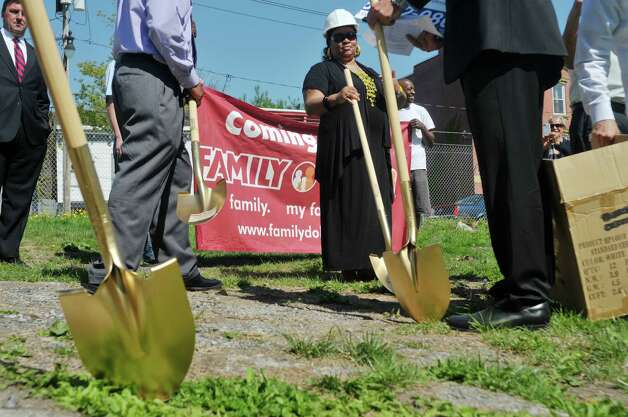 Shovels are handed out  at a groundbreaking for a Family Dollar store in Albany's South End on Thursday, May 7, 2015, in Albany, N.Y.  The 8,320 square-foot store will be open in the fall before the holidays and will employ between 10 and 12 people.  The store will being interviewing candidates for jobs about three weeks before the store opens and will advertise when the interviews begin.  The current building on the site will be knocked down and the ground will be raised to street level before a new building is constructed.  Vanguard-Fine Commercial Real Estate is the developer on the project.  Family Dollar has 8,000 stores nationwide.  (Paul Buckowski / Times Union) Photo: PAUL BUCKOWSKI / 00031720A