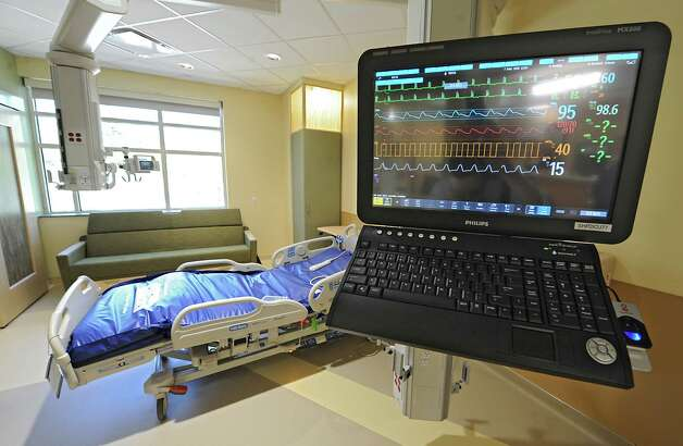 Monitor in a patient's room in the new Marylou Whitney and Desmond DelGiacco, MD Intensive Care Unit at Saratoga Hospital on Thursday, May 7, 2015 in Saratoga Springs, N.Y. The monitor, which also swivels and moves over to the patients bed, can also be used for other functions such as ordering prescriptions. (Lori Van Buren / Times Union) Photo: Lori Van Buren / 00031673A