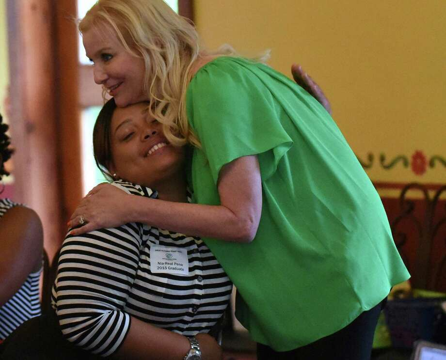 Angie Mock, CEO of the Boys & Girls Club of San Antonio embraces Nia-Real Pena during the graduation and scholarship reception for seniors active in the Boys & Girls Club at Casa Hernan on Wednesday, May 6, 2015. Photo: Billy Calzada, Staff / San Antonio Express-News / San Antonio Express-News
