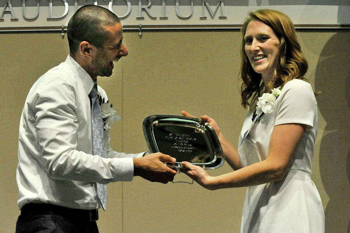 The 2015-2016 Stamford Teacher of the Year award is given to Jessica Chaapel from 2014-2015 Teacher of the Year recipient Jimmy Sapia during the Stamford Teacher of the Year awards ceremony at UConn in Stamford, Conn., on Thursday, May 7, 2015. Chaapel is a Davenport Ridge Elementary third grade teacher.