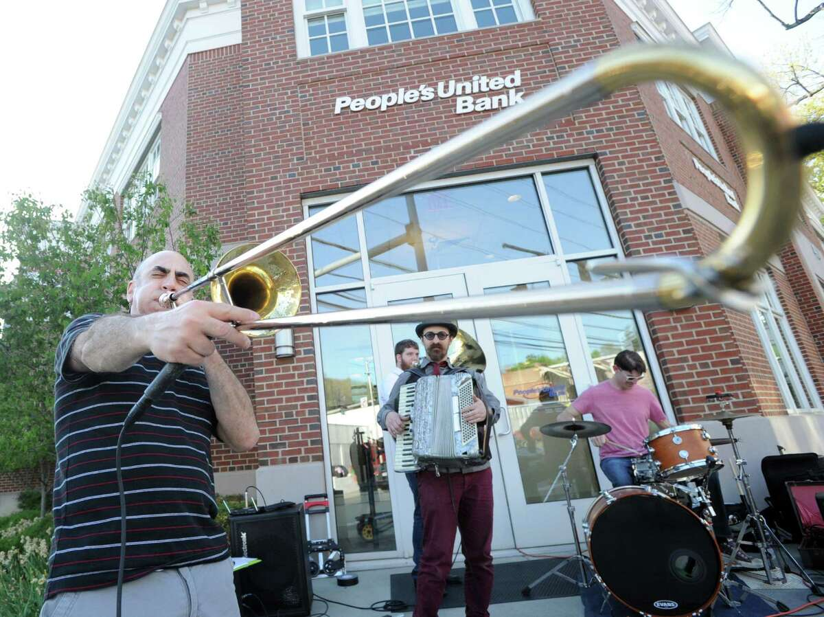 Greenwich resident Vinny Nobile blows his trombone as he and the band the Trummytones entertained during the opening night of Art to the Avenue, organized by the Greenwich Arts Council as an annual spring celebration of art and artists on Greenwich Avenue, Thursday evening, May 7, 2015. According to Paul Master- Karnik, executive director of the Greenwich Arts Council, the art will be on display for the rest of the month in all participating stores. Master- Karnik said 140 artists are showing their work.