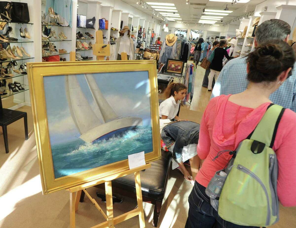 A painting of a sailboat on Long Island Sound, by Scarsdale, N.Y. artist, Patt Baldino, was on display in the Shores-N-More store during the opening night of Art to the Avenue, organized by the Greenwich Arts Council as an annual spring celebration of art and artists on Greenwich Avenue, Thursday evening, May 7, 2015. According to Paul Master- Karnik, executive director of the Greenwich Arts Council, the art will be on display for the rest of the month in all participating stores. Master- Karnik said 140 artists are showing their work.