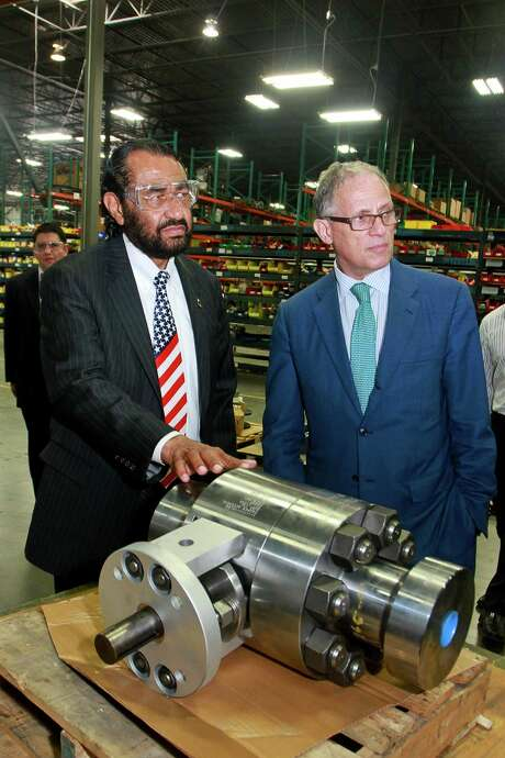 U.S. Rep. Al Green (left) and Export-Import Bank Chairman and President Fred Hochberg tour Cooper Valves on Thursday in Stafford. Photo: Gary Fountain /For The Houston Chronicle / Copyright 2015 by Gary Fountain