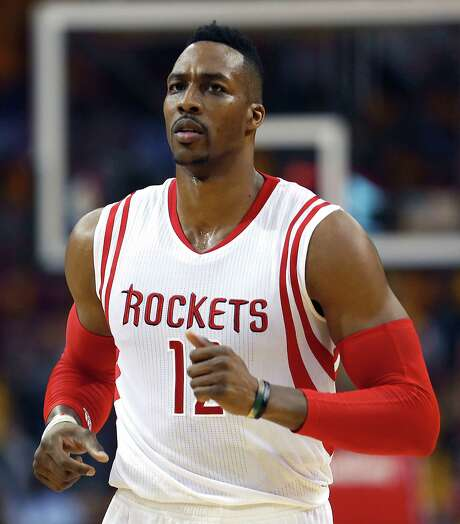 Rockets center Dwight Howard wears a look that should appease those who think he smiles excessively. Photo: James Nielsen, Staff / © 2015  Houston Chronicle