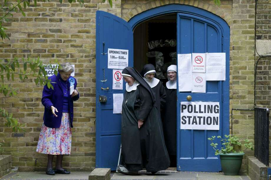 Exit polls from the general election project the Conservative Party of Prime Minister David Cameron would get 316 seats in Parliament, more than predicted. Photo: JUSTIN TALLIS, Stringer / AFP