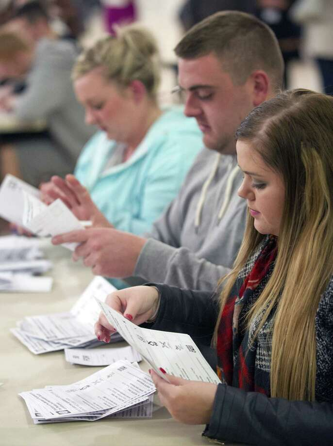 Counting staff sort ballot papers at the counting centre for Paisley and Renfrewshire at the Lagoon Leisure Centre, Paisley, Scotland on May 7, 2015 during the British general election. Prime Minister David Cameron's Conservatives are on course to be the biggest party in the next British parliament, according to an exit poll from the general election on Thursday showing them winning far more seats than had been expected. AFP PHOTO / LESLEY MARTINLESLEY MARTIN/AFP/Getty Images Photo: LESLEY MARTIN, Stringer / AFP / Getty Images / © Lesley Martin 2015