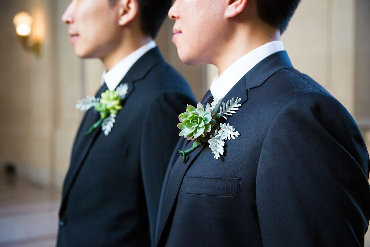 Alvin Wong and Long Le's friend made their drought-friendly boutonnieres from succulents in his backyard. They intend to reuse them at their reception dinner. City Hall, Friday May 1, 2015, in San Francisco, CA.