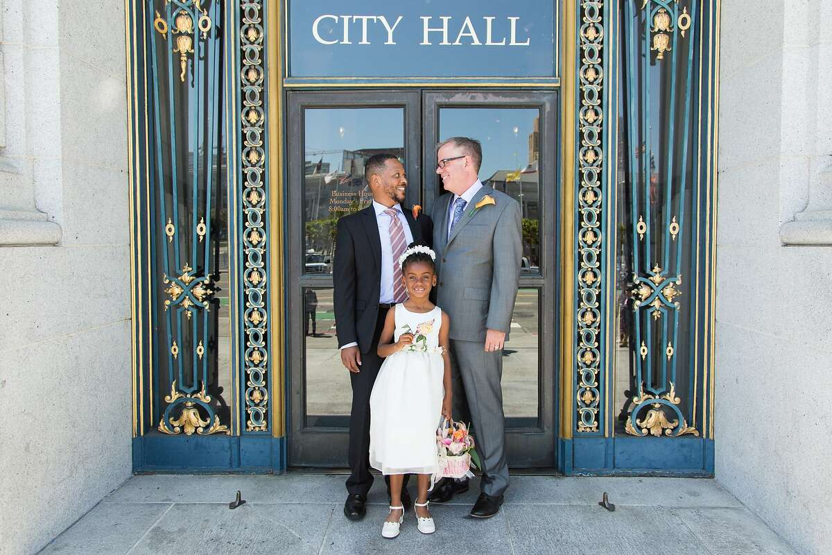 Juan Doubrechat, Delali Suggs-Akaffu and Bob Collins pose for a photo outside City Hall, Friday May 1, 2015, in San Francisco, CA.