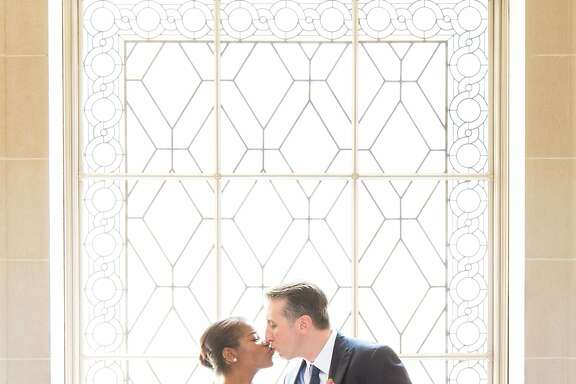 Sean LaRrett and Jewel Robinson, sports lovers who met online in 2012, share a kiss after their wedding ceremony at City Hall, Friday May 1, 2015, in San Francisco, CA.