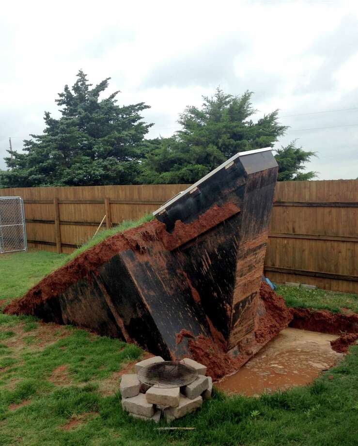 This photo by KOCO shows a storm shelter that came out of the ground after four inches of rain fell Tuesday night, May 5, 2015 through Wednesday morning in Noble, Okla. a surrounding community of Norman. The owner had to find alternative cover during Wednesday evenings' storms said KOCO reporter Morgan Chesky. Spring storms spawned more than a dozen suspected tornadoes in the southern Plains, destroying dozens of homes, causing flooding and forcing the evacuation of Oklahoma City's main airport. At least 12 people were injured but there were no reports of deaths. (Morgan Chesky/KOCO via AP) Photo: Morgan Chesky, HONS / Associated Press / KOCO