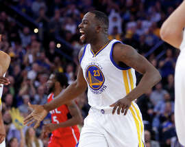 Golden State Warriors' Draymond Green celebrates his off balance 3-pointer to beat the shot clock in 2nd quarter against Atlanta Hawks during NBA game at Oracle Arena in Oakland, Calif., on Wednesday, March 18, 2015.