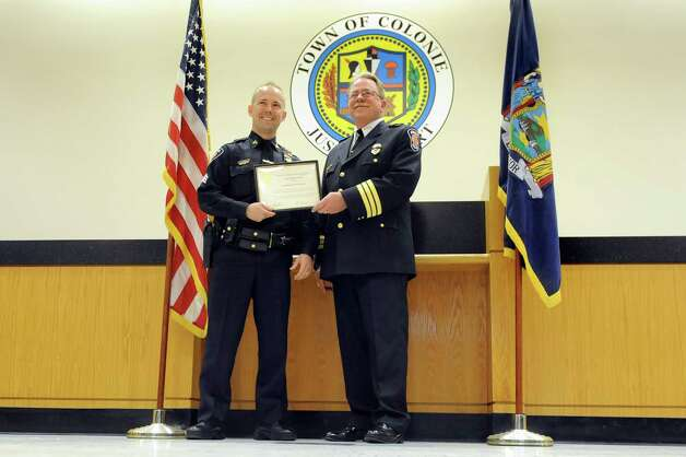 Sgt. Louis DiNuzzo, left, receives a Life Saving Award from Chief Steven Heider during the Colonie Police Department awards ceremony on Thursday, May 7, 2015,  at the Colonie Public Safety Building in Colonie, N.Y. (Cindy Schultz / Times Union) Photo: Cindy Schultz / 00031750A
