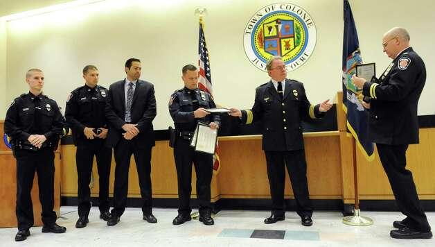 Chief Steven Heider, second from right, hands out Command Recognition Awards to members of the force during the Colonie Police Department awards ceremony on Thursday, May 7, 2015,  at the Colonie Public Safety Building in Colonie, N.Y. (Cindy Schultz / Times Union) Photo: Cindy Schultz / 00031750A