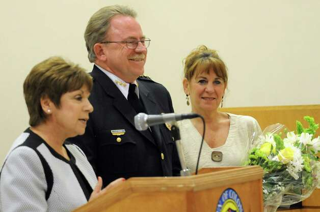 Chief Steven Heider, center, and his wife, Laurie Heider, right, react as Supervisor Paula Mahan talks about the chief during the Colonie Police Department awards ceremony on Thursday, May 7, 2015, at the Colonie Public Safety Building in Colonie, N.Y. Chief Heider, who will retire soon, received recognition for outstanding excellence. (Cindy Schultz / Times Union) Photo: Cindy Schultz / 00031750A