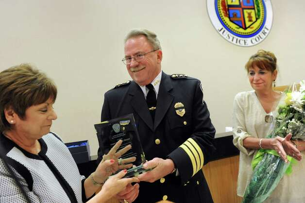 Chief Steven Heider, center, receives an award for Outstanding Excellence from Supervisor Paula Mahan, left, during the Colonie Police Department awards ceremony on Thursday, May 7, 2015, at the Colonie Public Safety Building in Colonie, N.Y. At right is his wife, Laurie Heider. (Cindy Schultz / Times Union) Photo: Cindy Schultz / 00031750A
