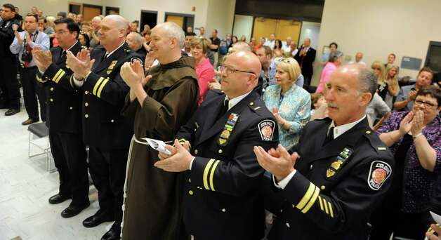 Chief Steven Heider, who will retire soon, receives a standing ovation during the Colonie Police Department awards ceremony on Thursday, May 7, 2015, at the Colonie Public Safety Building in Colonie, N.Y. (Cindy Schultz / Times Union) Photo: Cindy Schultz / 00031750A