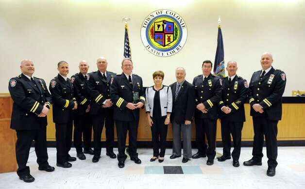 Chief Steven Heider, fifth from left, and Supervisor Paula Mahan, center, pose with members of the Colonie Police Department during their awards ceremony on Thursday, May 7, 2015, at the Colonie Public Safety Building in Colonie, N.Y. (Cindy Schultz / Times Union) Photo: Cindy Schultz / 00031750A