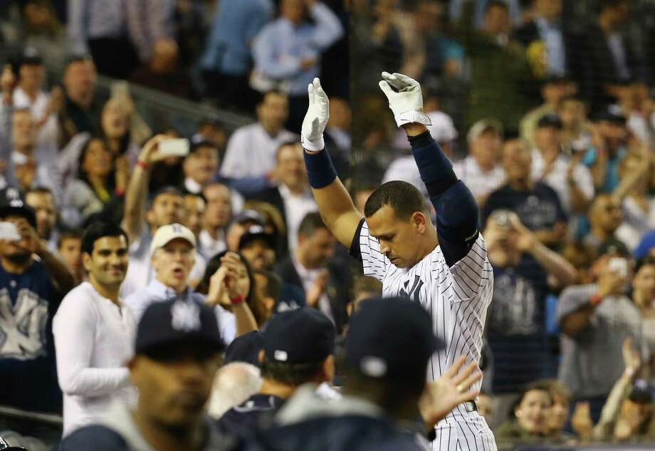 The Yankees' Alex Rodriguez acknowledges the crowd after hitting his 661st home run to pass Willie Mays for fourth on the career list. Photo: Al Bello, Staff / 2015 Getty Images