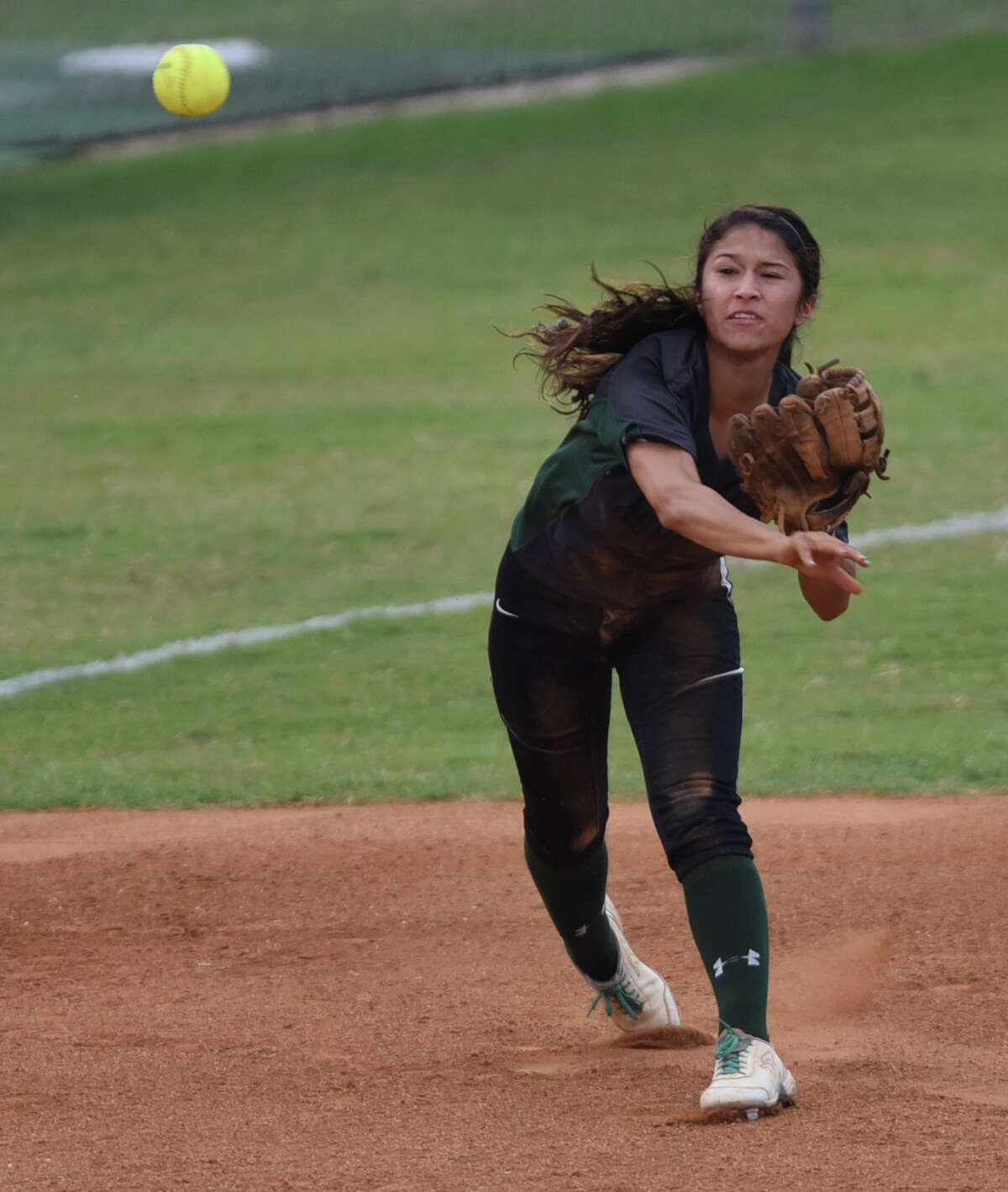 Kristal Salinas of Southwest throws to first to double out a Johnson runner after she speared a line drive during game 1 of the Class 6A second-round high school softball series between Johnson and Southwest at the SAISD complex Thursday, May 7, 2015.