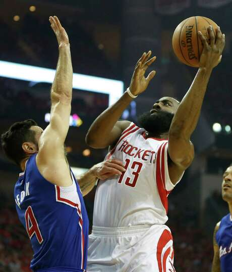 Rockets guard James Harden, right, says he started to find some holes in the defensive tactics of JJ Redick and his Clippers teammates during Game 2. Photo: James Nielsen, Staff / © 2015  Houston Chronicle