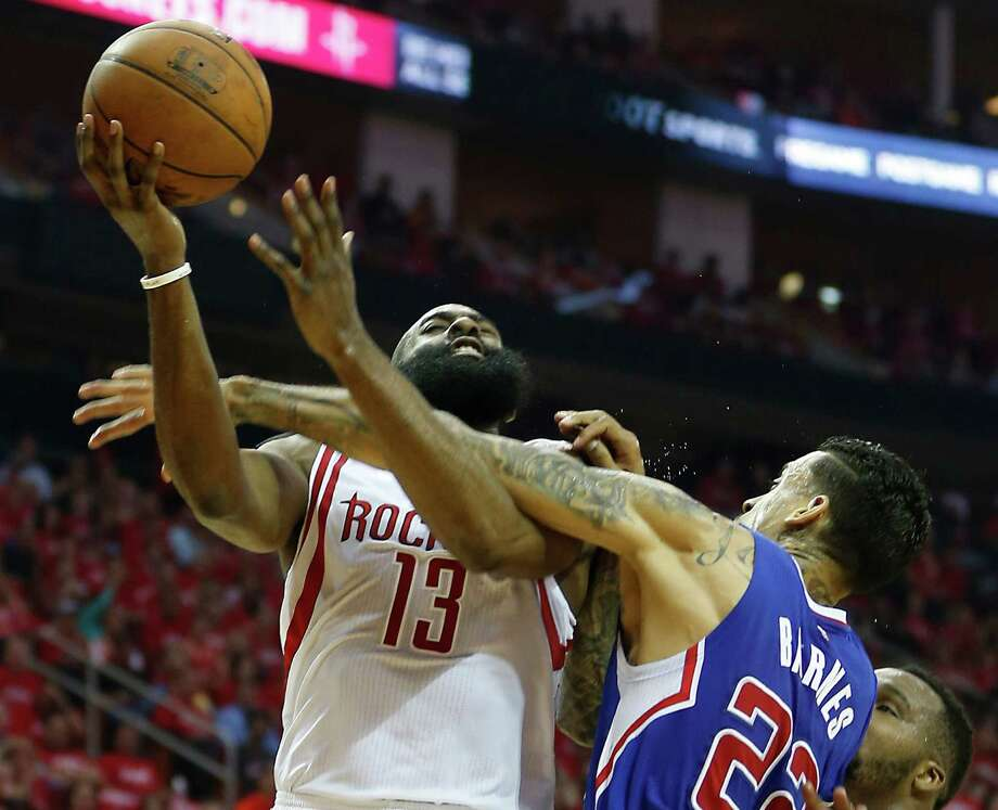 Matt Barnes, right, had a busy Game 2 between fouling James Harden and trash-talking Harden's mother, who later got an apology from the Clipper. Photo: James Nielsen, Staff / © 2015  Houston Chronicle