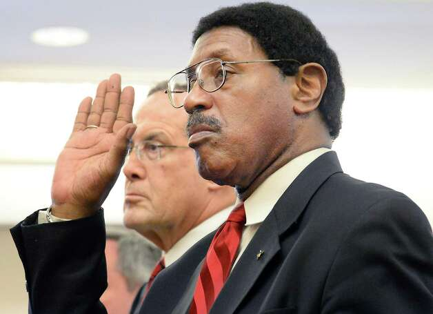Assemblyman William Scarborough, right, is sworn in accompanied by his defense attorney E. Stewart Jones in Albany County Court Thursday May 7, 2015 in Albany, NY.  At left is Asst. AG Christopher Baynes and  is at right.  (John Carl D'Annibale / Times Union) Photo: John Carl D'Annibale / 00031749A