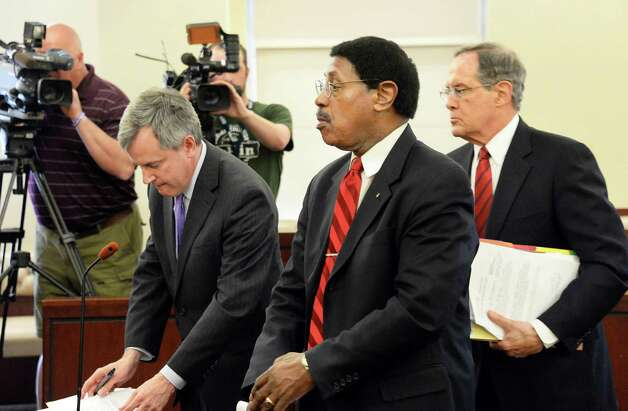 Assemblyman William Scarborough, center, appears before Judge Stephen W. Herrick in Albany County Court Thursday May 7, 2015 in Albany, NY.  At left is Asst. AG Christopher Baynes and defense attorney E. Stewart Jones is at right.  (John Carl D'Annibale / Times Union) Photo: John Carl D'Annibale / 00031749A
