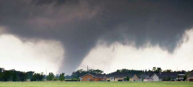 A tornado passes near Halstead, Kan., Wednesday, May 6, 2015. A swath of the Great Plains is under a tornado watch Wednesday, including parts of North Texas, Oklahoma, Kansas and Nebraska. (Travis Heying/The Wichita Eagle via AP)   ORG XMIT: KSWIE101 Photo: Travis Heying / The Wichita Eagle
