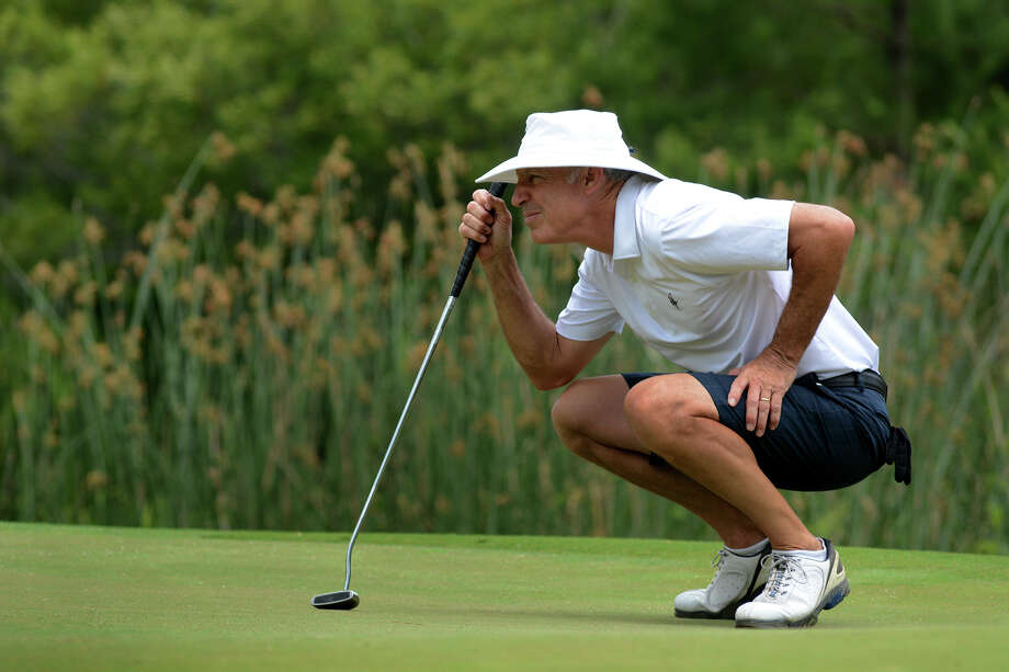 Lee Sandlin, of Dallas, lines up his putt on the par 3 17th hole during the final round of the 10th Annual Carlton Woods Invitational on Thursday, May 7, 2015. Sandlin won the Senior Division of the tournament by three strokes with a 36-hole score of 143. Photo: Jerry Baker, Freelance