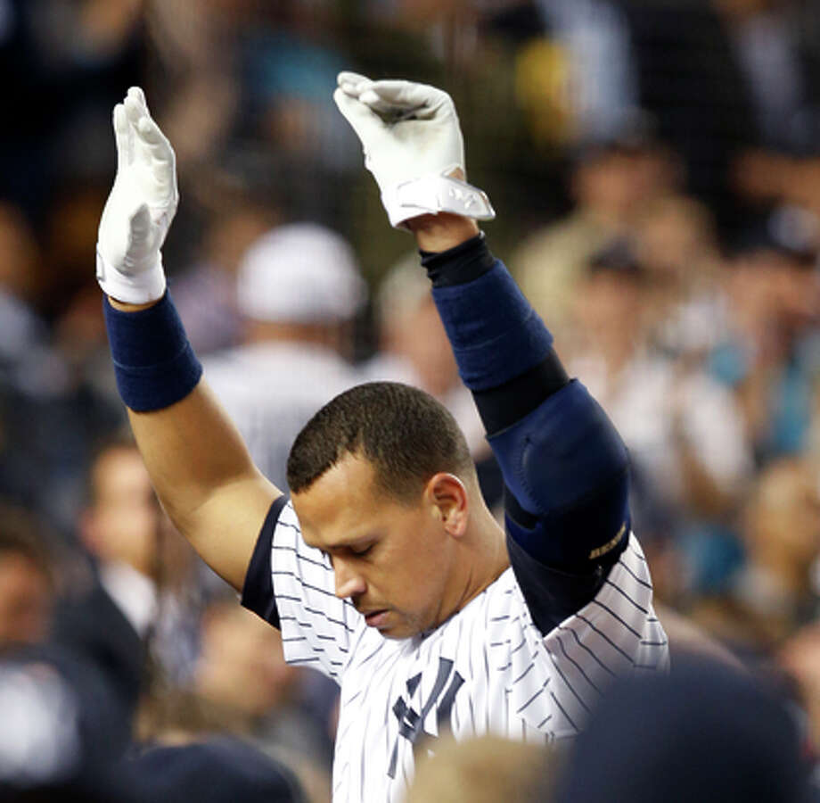 Alex Rodriguez takes a curtain call after milestone. Photo: Kathy Willens / Associated Press / AP